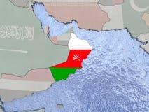 Oman with flag on globe Stock Photo