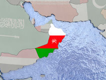 Oman with flag on globe Stock Images