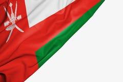 Oman flagga av tyg med copyspace för din text på vit bakgrund royaltyfri illustrationer