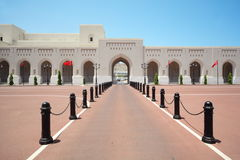 Oman flags on main avenue of Sultan's Palace Royalty Free Stock Photo