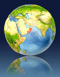 Oman on globe with reflection. Illustration with detailed planet surface. Elements of this image furnished by NASA Royalty Free Stock Photo