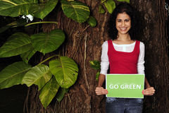 Oman holding a go green sign Royalty Free Stock Photos