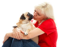 Oman kissing a pug Royalty Free Stock Photography