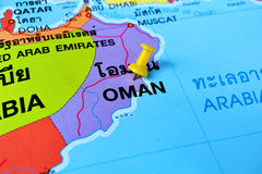 Oman map. Macro shot of oman map with push pin Royalty Free Stock Photo
