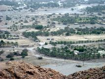Oman mitt- dagöken mellan kusten och berg arkivfoto