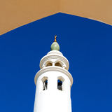 in oman muscat the old mosque minaret and religion in clear sky Stock Image