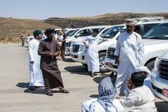 Oman Salalah Local arab people talking during Jeep Tour dofar Mountains Sultanate 17.10.2016. stock photos