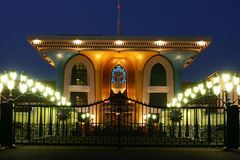 Oman, Sultan's palace in Muscat at night. Oman - Al Alam Palace of sultan Al Qaboos bin Said in Muscat at night. The palace has a facade of gold and blue and was Stock Photos