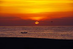 Oman Sunrise. Fishermans silhouette in sunrise in Oman Stock Image