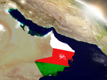 Oman z flaga w powstającym słońcu Fotografia Royalty Free