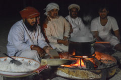 Omani Bedu cooking Stock Photography