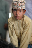 Omani boy with traditional clothing. Boy with traditional clothing in Oman, at a goat market Stock Photo