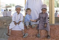 Omani boys with an european boy Stock Photo