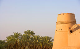 Omani Castle. A beautifully decorated tower at Al Khandaq Castle, one of several castles in the verdant oasis town of Al Buraymi in the Sultanate of Oman. A palm Royalty Free Stock Photography