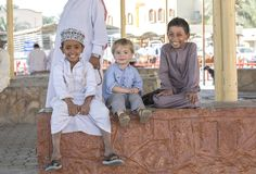 Omani and european kids making friends stock image