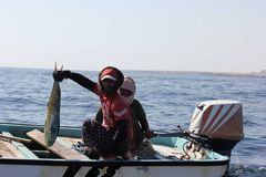 Omani Fishermans and their fish Royalty Free Stock Photography