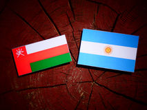 Omani flag with Argentinian flag on a tree stump isolated Stock Photography