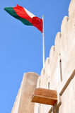 Omani Flag Atop Khasab Fort. The Omani flag atop a fort in Khasab, Musandam (Oman royalty free stock image