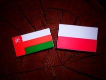 Omani flag with Polish flag on a tree stump isolated. Omani flag with Polish flag on a tree stump vector illustration