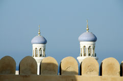 Omani fort and minarets Royalty Free Stock Photos