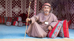 An Omani man lounging. Stock Images