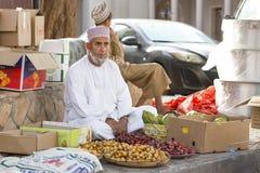 Omani man selling new season dates at a street market in Nizwa Royalty Free Stock Photography