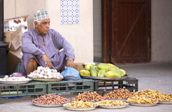 Omani man selling new season dates at a street market in Nizwa Stock Images