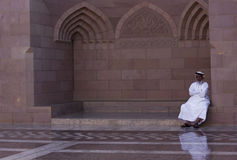 Omani man sit outside the mosque Stock Photo