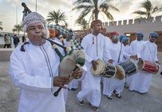 Omani men playing drums and singing Stock Image