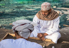 Omani men playing a traditional game. Stock Photo