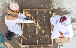 Omani men playing a traditional game. Stock Photos