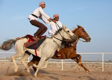 Omani men showing off their riding skills. Stock Photo