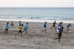 Omani playing soccer on the beach in Muscat Royalty Free Stock Photography