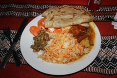 Omani typical dish. Rice with chicken or beef, marinated with special spices, like 'qabuli with lamb meat' or lamb biryani, djaj foug el eish. Similarly Stock Images