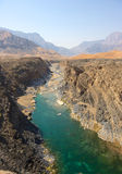 Omani Wadi. Water has cut through desert rock to create Wadi Dyqah, one of the most beautiful natural landscapes in the Sultanate of Oman Stock Image
