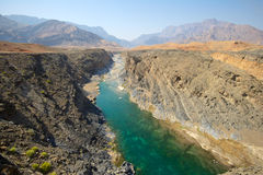 Omani Wadi. Water has cut through desert rock to create Wadi Dyqah, one of the most beautiful natural landscapes in the Sultanate of Oman Stock Photography