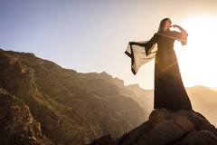Omani woman in the mountains Royalty Free Stock Photo