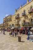 Omar Ben el-Hatab street, old city of Jerusalem. Jerusalem, Israel - April 6, 2018: Scene of Omar Ben el-Hatab street, near the Jaffa gate, with locals and Royalty Free Stock Photo