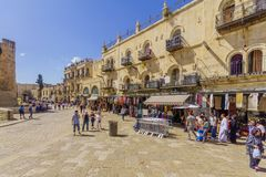 Omar Ben el-Hatab street, old city of Jerusalem. Jerusalem, Israel - April 6, 2018: Scene of Omar Ben el-Hatab street, near the Jaffa gate, with locals and Royalty Free Stock Photography