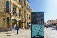 Omar Ben el-Hatab street, old city of Jerusalem. Jerusalem, Israel - April 6, 2018: Scene of Omar Ben el-Hatab street, near the Jaffa gate, with directional Stock Photos