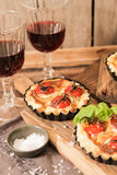 Omato quiche with wine the national France. Tomato quiche with wine the national prescription France royalty free stock images