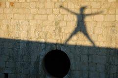 Ombra che salta sulla parete Fotografia Stock Libera da Diritti