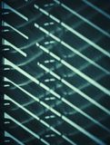 Ombra dei ciechi sulla parete Immagini Stock