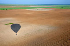 Ombra del pallone di aria calda Fotografie Stock