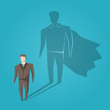 Ombra dell'eroe dell'uomo d'affari Fotografia Stock Libera da Diritti