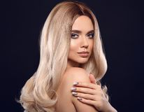 Ombre blond wavy hair. Beauty fashion blonde woman portrait. Beautiful girl model with makeup, long healthy hairstyle, manicured