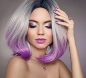 Ombre bob hair coloring woman. Beauty Portrait of blond model wi. Th short shiny purple hairstyle.Fashion amethyst jewelry set. Expensive pendant and ring Royalty Free Stock Image