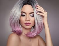 Ombre bob pink hair woman. Glitter Makeup. Manicure nails. Beaut. Y Portrait of blond model with short shiny hairstyle. Concept Coloring Hair. Fashion jewelry Royalty Free Stock Image
