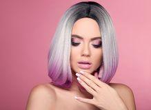 Ombre bob short hairstyle and manicured nails. Beauty makeup. Beautiful hair coloring woman with wow face holding hand near her stock photography