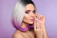 Ombre bob short hairstyle. Woman portrait with blond purple hair and manicured nails. Beauty makeup. Beautiful girl model isolated